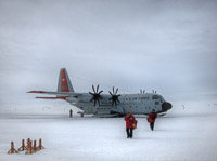 Cryogenics technicians Kathleen Dewahl and Flint Hamblin arrive at the South Pole after a three hour flight from McMurdo Station on the coast of Antarctica. (<i>Steffen Richter, Harvard University</i>)