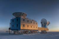 The Dark Sector Lab (DSL), located 3/4 of a mile from the Geographic South Pole, houses the BICEP2 telescope (left) and the South Pole Telescope (right). (<i>Steffen Richter, Harvard University</i>)